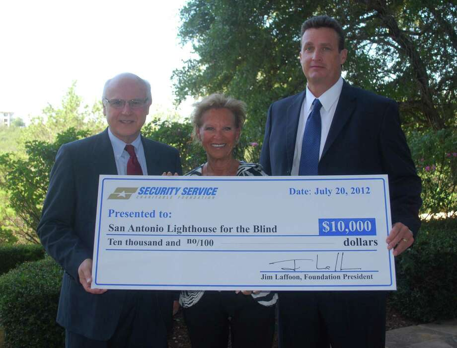 Pictured from the right are Jim Laffoon, Security Service Federal Credit Union; Nancy Lipton, S.A. Lighthouse for the Blind; and Bill Cichoski, S.A. Lighthouse for the Blind. Photo: Courtesy Photo