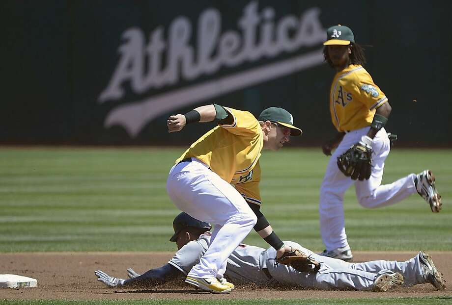 Asdrubal Cabrera #13 of the Cleveland Indians steals second  base sliding past the tag of Cliff Pennington #2 of the Oakland Athletics in the first inning at O.co Coliseum on August 19, 2012 in Oakland, California.  (Photo by Thearon W. Henderson/Getty Images) Photo: Thearon W. Henderson, Getty Images