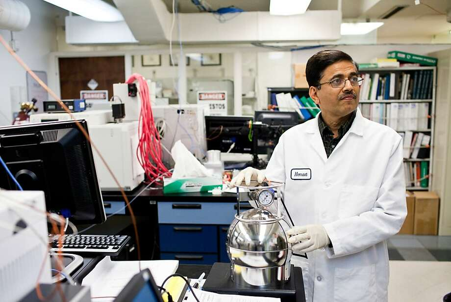 Hemant Amin, an air quality chemist, stands with one of the few canisters deployed during and after the Chevron refinery fire in Richmond to collect air samples for testing at the Bay Area Air Quality Management District lab in San Francisco. Photo: Jason Henry, Special To The Chronicle