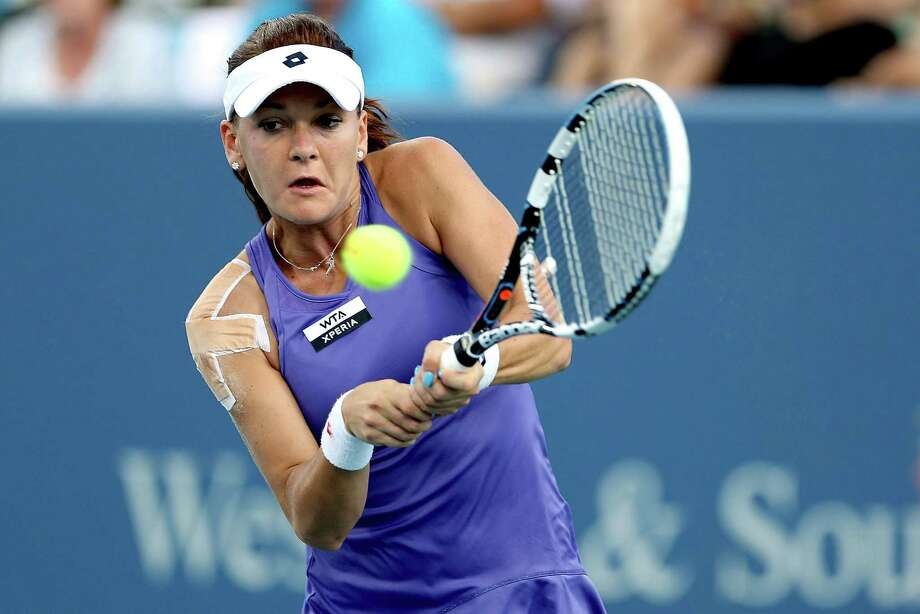 MASON, OH - AUGUST 17: Agnieszka Radwanska of Poland returns a shot to Li Na of China during the Western & Southern Open at the Lindner Family Tennis Center on August 17, 2012 in Mason, Ohio.  (Photo by Matthew Stockman/Getty Images) Photo: Matthew Stockman, Getty Images / 2012 Getty Images