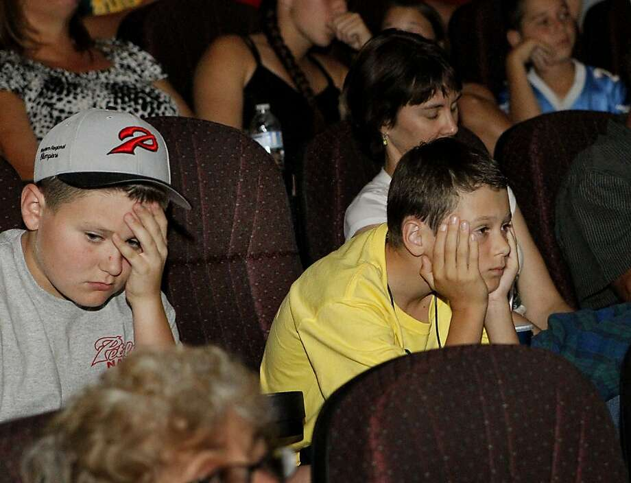At Boulevard Cinemas, Griffin Sisemore (left) and Alex Dodd watch Petaluma lose in the Little League World Series. Photo: Brant Ward, The Chronicle