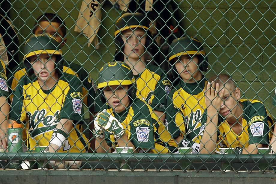 Members of the Petaluma, Calf. Little League team watch the final out of a 9-6 loss to Goodlettsville, Tenn. in a baseball game during Little League World Series pool play in South Williamsport, Pa., Sunday, Aug. 19, 2012. (AP Photo/Gene J. Puskar) Photo: Gene J. Puskar, Associated Press