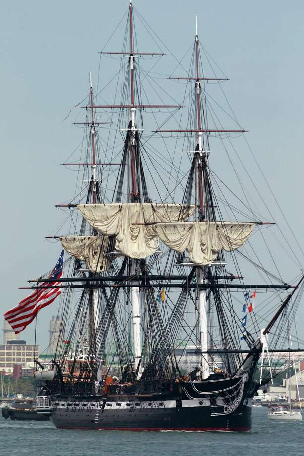 The USS Constitution is escorted by a tugboat in Boston Harbor in Boston, Sunday, Aug. 19, 2012. The USS Constitution, the U.S. Navy's oldest commissioned war ship, sailed under her own power during the event Sunday for the first time since 1997. The sail was held to commemorate the 200th anniversary of the ship's victory over HMS Guerriere in the War of 1812. (AP Photo/Steven Senne) Photo: Steven Senne, Associated Press / AP