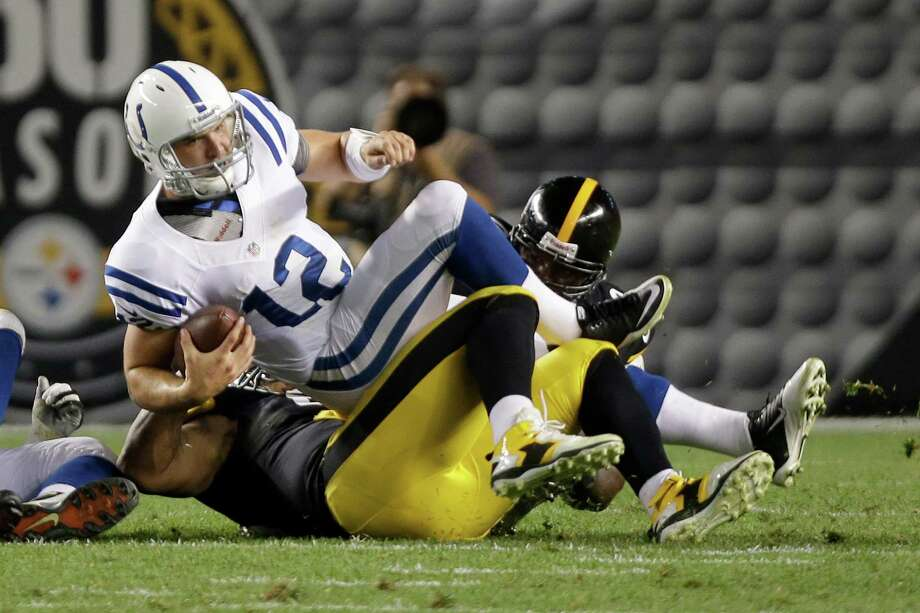 Indianapolis Colts quarterback Andrew Luck (12) is sacked by the s\ defense in the first quarter of the NFL preseason football game in Pittsburgh, Sunday, Aug. 19, 2012. (AP Photo/Mark Duncan) Photo: Mark Duncan, Associated Press / AP