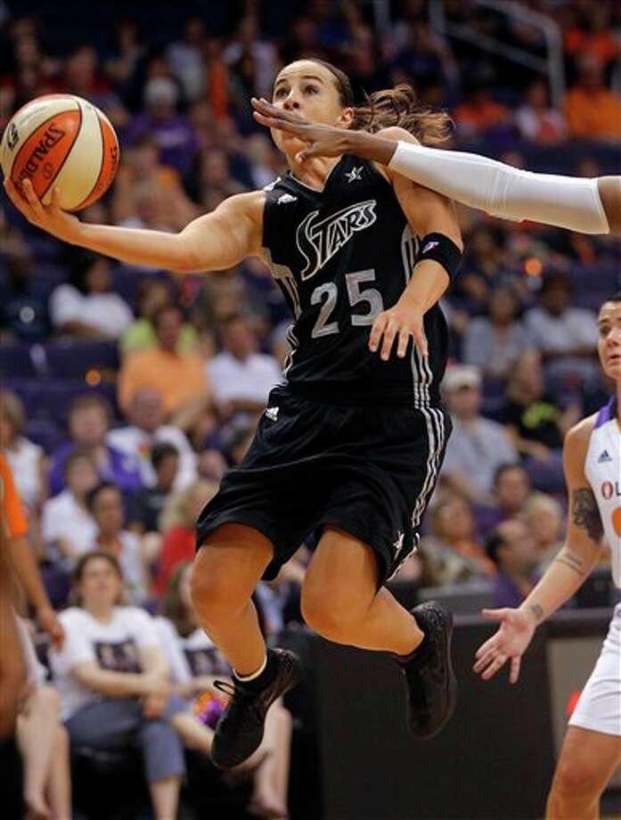 San Antonio Silver Stars guard Becky Hammon (25) drives against the Phoenix Mercury during the first half of a WNBA basketball game on Sunday, Aug. 19, 2012, in Phoenix. (AP Photo/Matt York) Photo: Associated Press
