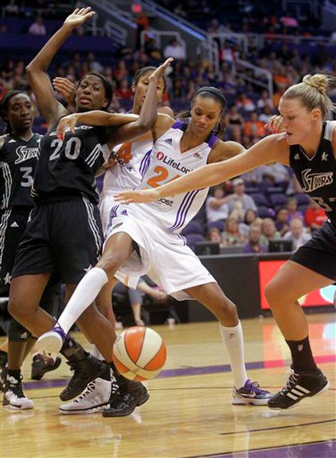 Phoenix Mercury forward Krystal Thomas, center, battles San Antonio Silver Stars forward Shameka Christon (20) and Jayne Appel, right, for the ball during the second half of a WNBA basketball game on Sunday, Aug. 19, 2012, in Phoenix. (AP Photo/Matt York) Photo: Associated Press