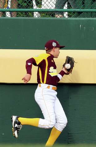 San Antonio McAllister Park's Kevin Fleisher catches a fly ball close to the right field wall during the bottom of the third inning against New Castle, Indiana in the 2012 Little League World Series in South Williamsport, Pennsylvania, Sunday, Aug. 19, 2012. San Antonio won 13-3. Photo: Jerry Lara, Express-News / © 2012 San Antonio Express-News