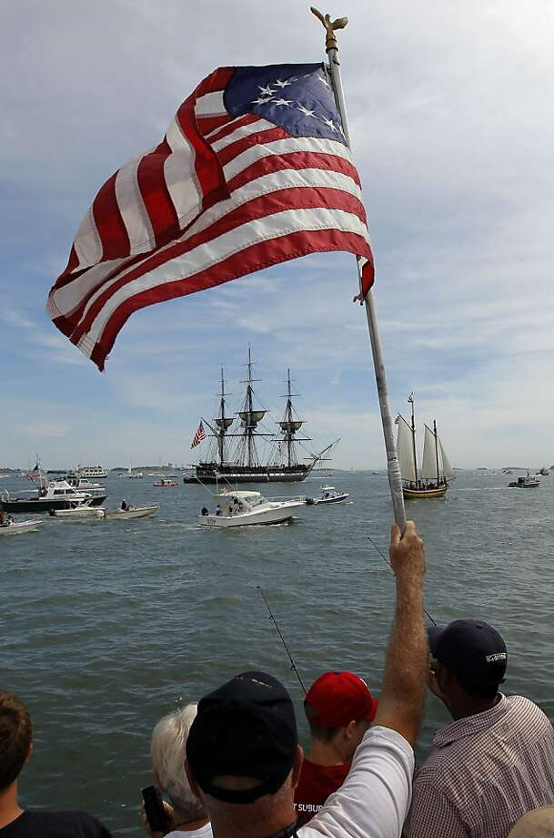 The battleship Constitution sails in Boston Harbor to commemorate its victory in the War of 1812. Photo: Steven Senne, Associated Press