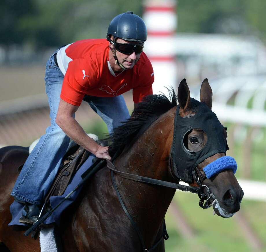 Liaison with regular exercise rider Simon Harris got his final work on the Saratoga Race Course in Saratoga Springs, N.Y. Aug 19, 2012 for Saturday's Travers Stakes. (Skip Dickstein/Times Union) Photo: Skip Dickstein