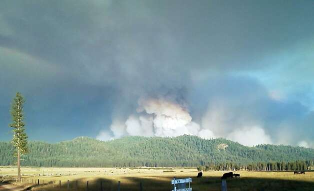 Smoke rises from a fire in Plumas County that has burned since July 29. Photo: Associated Press