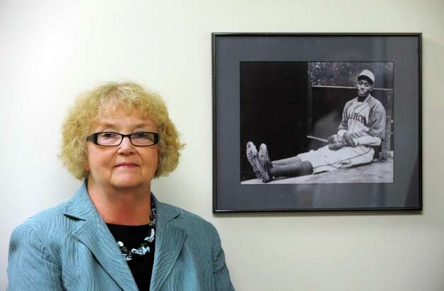 Wanda Fischer OMIG spokesperson with a photograph of baseball great Satchel Paige in Albany, NY Thursday Aug. 16, 2012. (Michael P. Farrell/Times Union) Photo: Michael P. Farrell