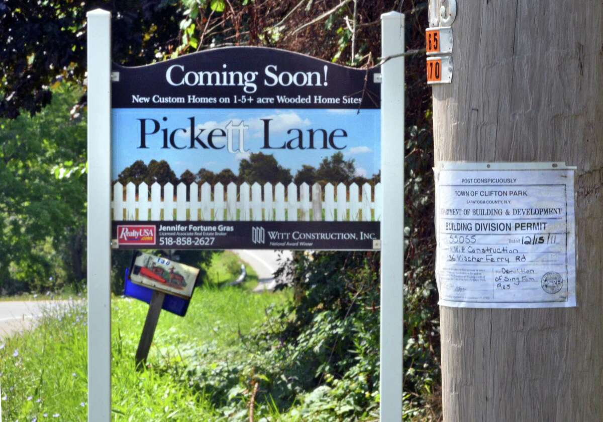 Building permit and Pickett Lane development sign at site of the former Manning Homestead at 136 Vischer Ferry Road, Clifton Park Thursday Aug. 16, 2012. (John Carl D'Annibale / Times Union)