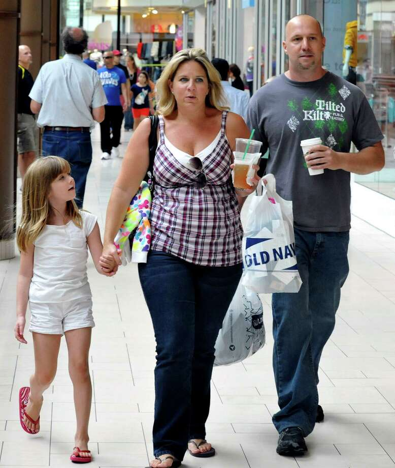 Emma Tomaselli, 7, of Brookfield, with her mom, Trish and Jamie Ambrogio shop for back-to-school cloths at the Danbury Fair mall on the first day of tax-free week Sunday, Aug. 19, 2012. Photo: Michael Duffy / The News-Times