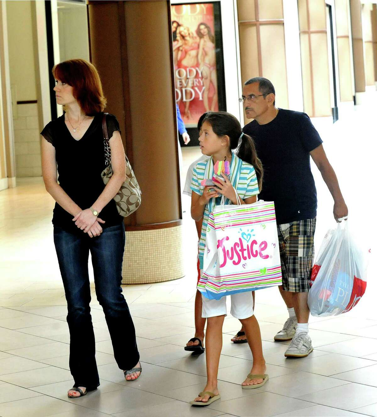 Area residents shop for back-to-school cloths at the Danbury Fair mall on the first day of tax-free week Sunday, Aug. 19, 2012.