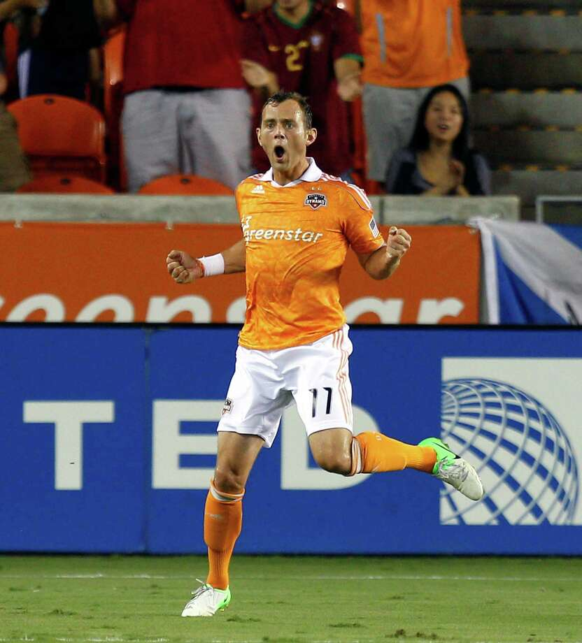 HOUSTON, TX - AUGUST 19: Brad Davis #11 of the Houston Dynamo celebrates after scoring on a shot inside the box in the first half against the Columbus Crew at BBVA Compass Stadium on August 19, 2012 in Houston, Texas. Photo: Bob Levey, Getty Images / 2012 Getty Images