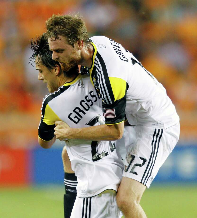 HOUSTON, TX - AUGUST 19: Cole Grossman #22 of the Columbus Crew is congratulated by Eddie Gaven #12 of the Columbus Crew after scoring in the first half against the Houston Dynamo  BBVA Compass Stadium on August 19, 2012 in Houston, Texas. Photo: Bob Levey, Getty Images / 2012 Getty Images