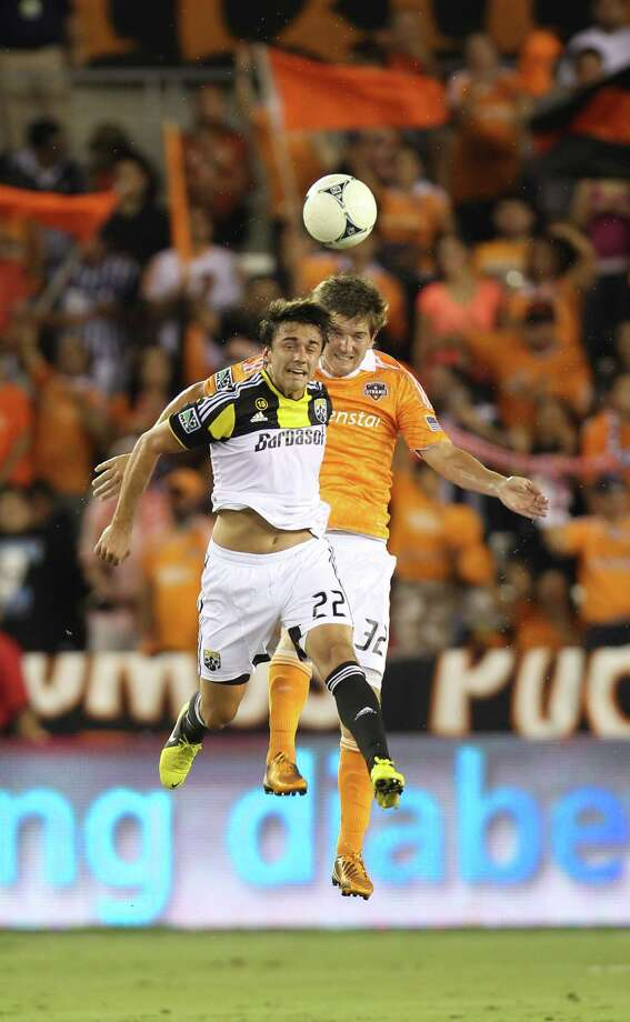 Columbus Crew midfielder Cole Grossman (22) and Houston Dynamo defender Bobby Boswell (32) go up for a header during the first half of an MLS soccer game at BBVA Compass Stadium, Sunday, Aug. 19, 2012, in Houston. Photo: Karen Warren, Houston Chronicle / © 2012  Houston Chronicle