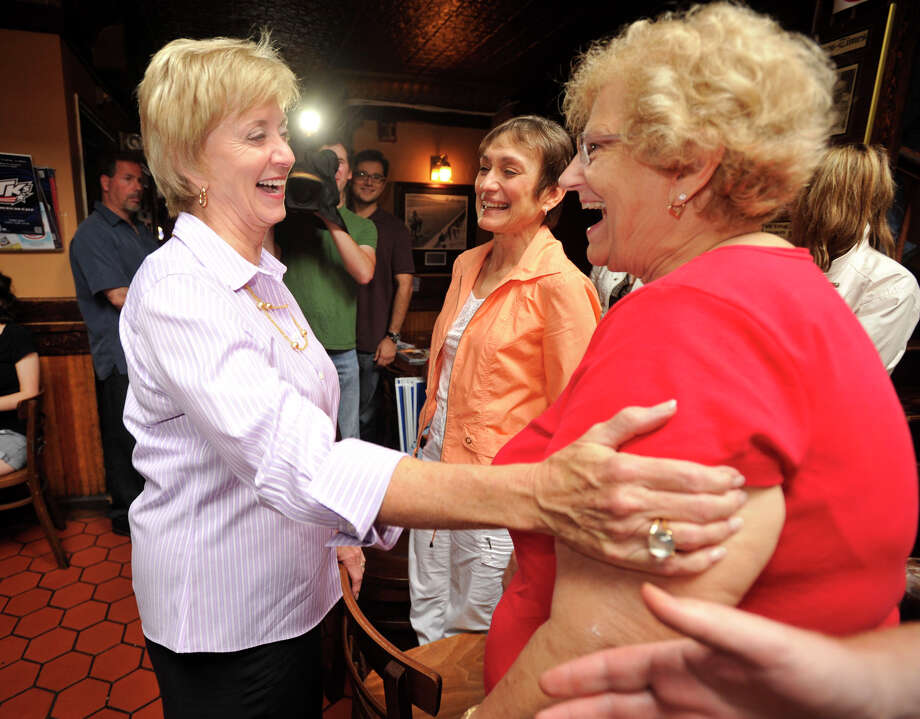 Linda McMahon, Republican candidate for the U.S. Senate, greets Pauline Basso, who works out of McMahon's Danbury office, at T.K.'s American Cafe durng McMahon's trip through Danbury on Wednesday, Aug. 15, 2012 the day after she won the Republican Primary. Photo: Jason Rearick / The News-Times