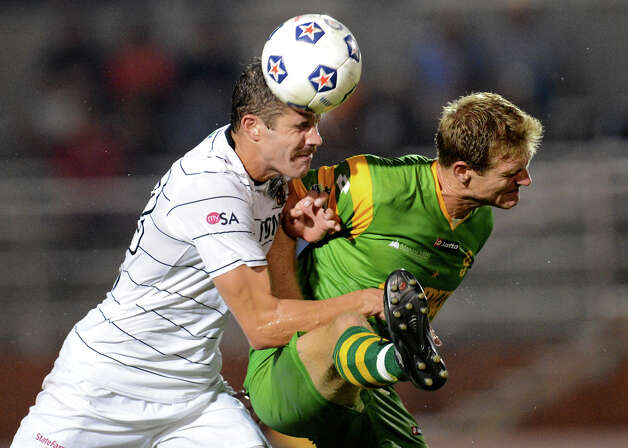 San Antonio Scorpions' Greg Janicki (left) heads a ball away from Tamp Bay's Daniel Antoniuk during a North American Soccer League (NASL) match between the San Antonio Scorpions and the Tampa Bay Rowdies on August 19, 2012 a Heroes Stadium in San Antonio Texas. John Albright / Special to the Express-News. Photo: JOHN ALBRIGHT, Express-News / San Antonio Express-News