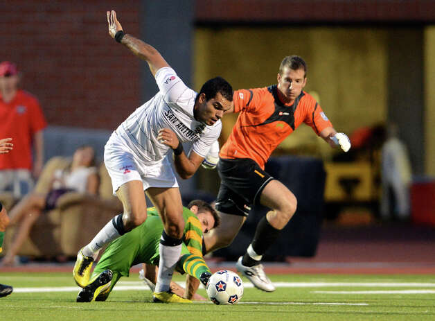 San Antonio Scorpions' Pablo Campos tries to make his way around Tampa Bay's Daniel Scott (2) and keeper Jeff Attinella during a North American Soccer League (NASL) match between the San Antonio Scorpions and the Tampa Bay Rowdies on August 19, 2012 a Heroes Stadium in San Antonio Texas.