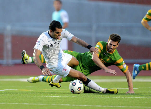 San Antonio Scorpions' Pablo Campos gets tangled up with Tampa Bay's Daniel Scott (2) during a North American Soccer League (NASL) match between the San Antonio Scorpions and the Tampa Bay Rowdies on August 19, 2012 a Heroes Stadium in San Antonio Texas.