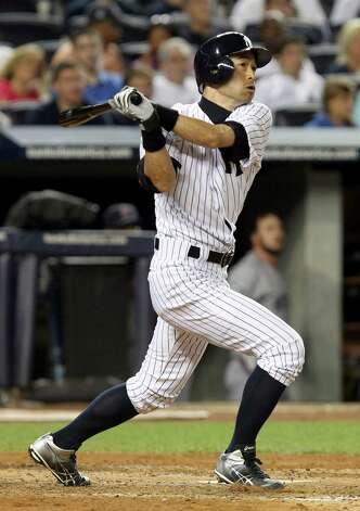New York Yankees' Ichiro Suzuki looks after his solo home run during the fourth inning of the baseball game against the Boston Red Sox Sunday, Aug. 19, 2012 at Yankee Stadium in New York.  (AP Photo/Seth Wenig) Photo: Seth Wenig