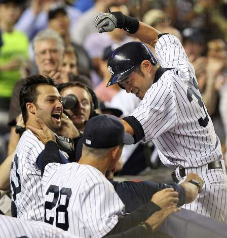 New York Yankees' Ichiro Suzuki, right, celebrates his second home run with Nick Swisher, left, and others as he returns to the dug out during the sixth inning of the baseball game against the Boston Red Sox Sunday, Aug. 19, 2012 at Yankee Stadium in New York.  (AP Photo/Seth Wenig) Photo: Seth Wenig