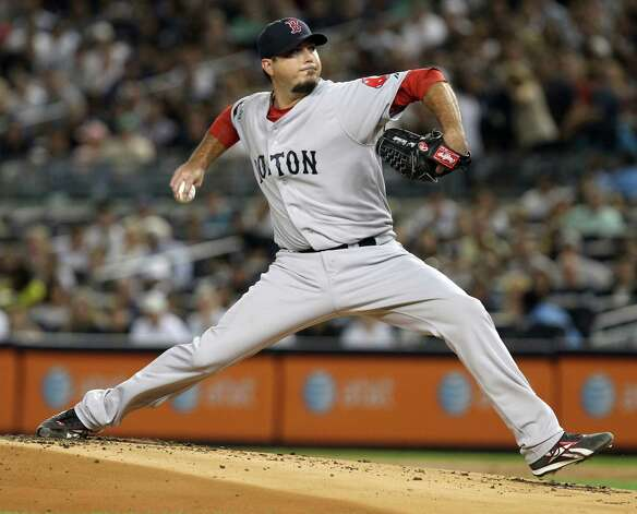 Boston Red Sox's Josh Beckett pitches during the first inning of the baseball game against the New York Yankees Sunday, Aug. 19, 2012 at Yankee Stadium in New York.  (AP Photo/Seth Wenig) Photo: Seth Wenig