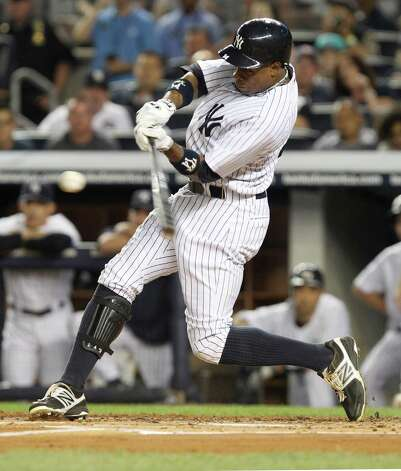 New York Yankees' Curtis Granderson hits an RBI double during the first inning of the baseball game against the Boston Red Sox Sunday, Aug. 19, 2012 at Yankee Stadium in New York.  (AP Photo/Seth Wenig) Photo: Seth Wenig