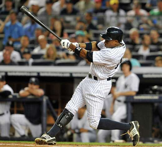 NEW YORK, NY - AUGUST 19: Curtis Granderson #14 of the New York Yankees connects on a RBI double to centerfield in the first inning against the Boston Red Sox at Yankees Stadium on August 19, 2012 in the Bronx borough of New York City. (Photo by Jason Szenes/Getty Images) Photo: Jason Szenes