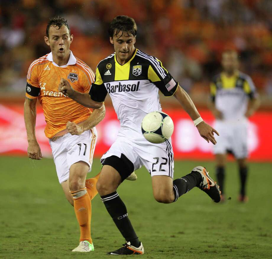 Houston Dynamo midfielder Brad Davis (11) battles against Columbus Crew midfielder Cole Grossman (22) during the second half of an MLS soccer game at BBVA Compass Stadium, Sunday, Aug. 19, 2012, in Houston. The game ended tied 2-2. Photo: Karen Warren, Houston Chronicle / © 2012  Houston Chronicle