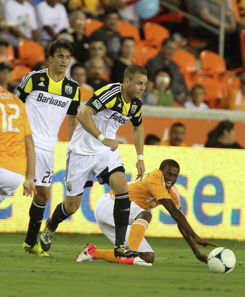 Houston Dynamo midfielder Boniek Garcia (27) reacts as he falls after colliding with Columbus Crew m