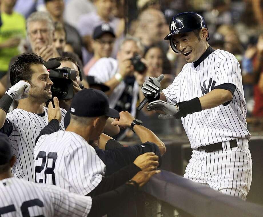 Ichiro Suzuki homered twice. Photo: Seth Wenig, Associated Press