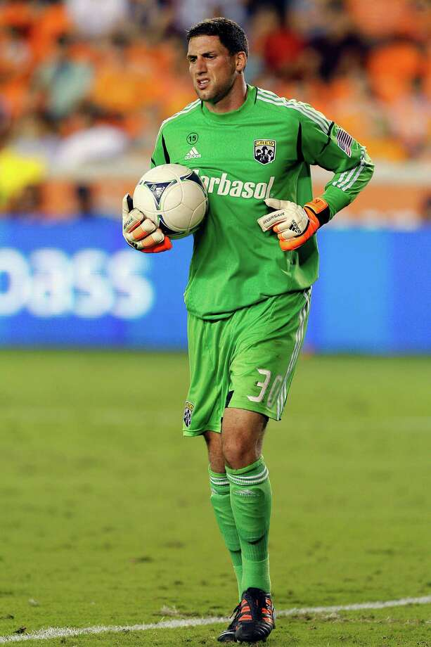 HOUSTON, TX - AUGUST 19:  Andy Gruenebaum #30 of the Columbus Crew comes up limping after a save against the Houston Dynamo at BBVA Compass Stadium on August 19, 2012 in Houston, Texas. Photo: Bob Levey, Getty Images / 2012 Getty Images