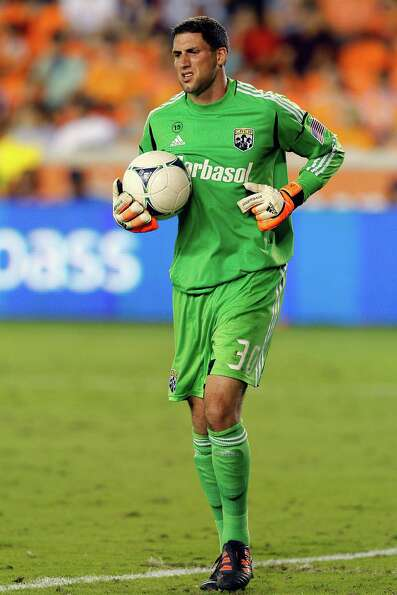 HOUSTON, TX - AUGUST 19:  Andy Gruenebaum #30 of the Columbus Crew comes up limping after a save aga