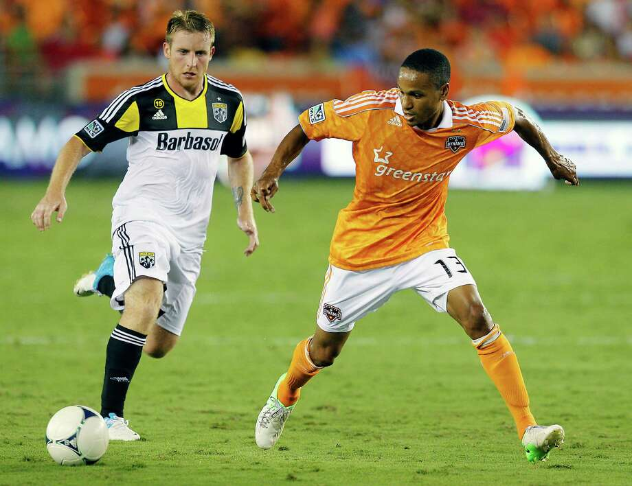 HOUSTON, TX - AUGUST 19:  Ricardo Clark #13 of the Houston Dynamo keeps the ball from Chad Marshall #14 of the Columbus Crew at BBVA Compass Stadium on August 19, 2012 in Houston, Texas. Photo: Bob Levey, Getty Images / 2012 Getty Images