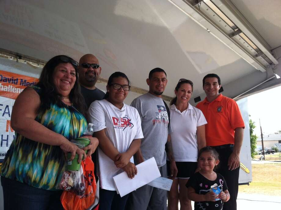Winner of $1,000 grand prize from the D5 Fit Family 1 Mile Health Walk was Armando Castro and his family. Pictured with the Castro family, District 5 Councilman David Medina and Mary Japhet with San Antonio Sports at Fit Family Challenge. Photo: Courtesy Photo