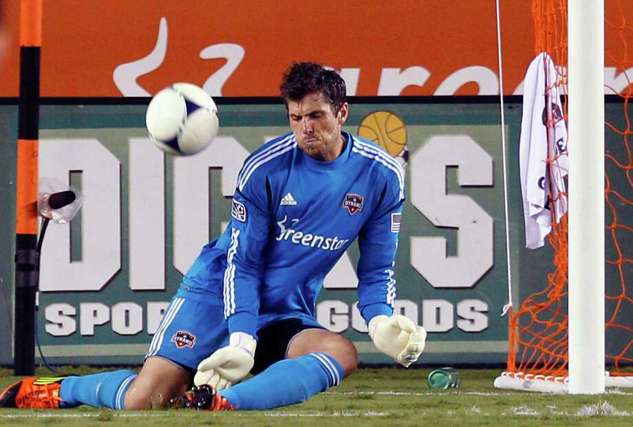 HOUSTON, TX - AUGUST 19: Tally Hall #1 of the Houston Dynamo makes a save against the Columbus Crew in the second half  at BBVA Compass Stadium on August 19, 2012 in Houston, Texas. Photo: Bob Levey, Getty Images / 2012 Getty Images
