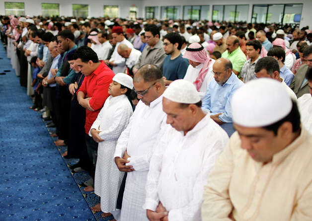 Men and boys pray during Eid al-Fitr, the end of Ramadan, Sunday Aug. 19, 2012 at the Islamic Center of San Antonio's new mosque. Ramadan, is the monthlong fast by Muslims from food, drink, and marital relations from dawn to sunset. Photo: Edward A. Ornelas, San Antonio Express-News / © 2012 San Antonio Express-News