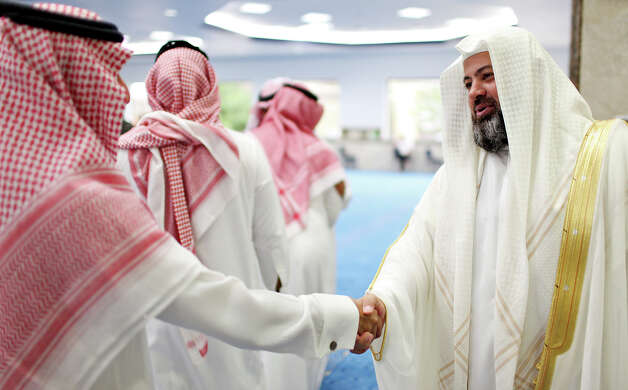 Islamic Center of San Antonio's Sheikh Yousef Said (right) greets men after the Eid al-Fitr, end of Ramadan, prayer Sunday Aug. 19, 2012 at the center. Ramadan, is the monthlong fast by Muslims from food, drink, and marital relations from dawn to sunset. Photo: Edward A. Ornelas, San Antonio Express-News / © 2012 San Antonio Express-News