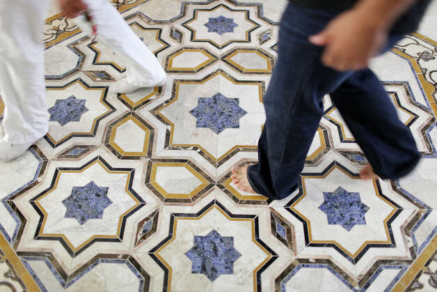 Men make their way through the Islamic Center of San Antonio's new mosque after the Eid al-Fitr,end of Ramadan, prayer Sunday Aug. 19, 2012 at the . Ramadan is the monthlong fast by Muslims from food, drink, and marital relations from dawn to sunset. Photo: Edward A. Ornelas, San Antonio Express-News / © 2012 San Antonio Express-News