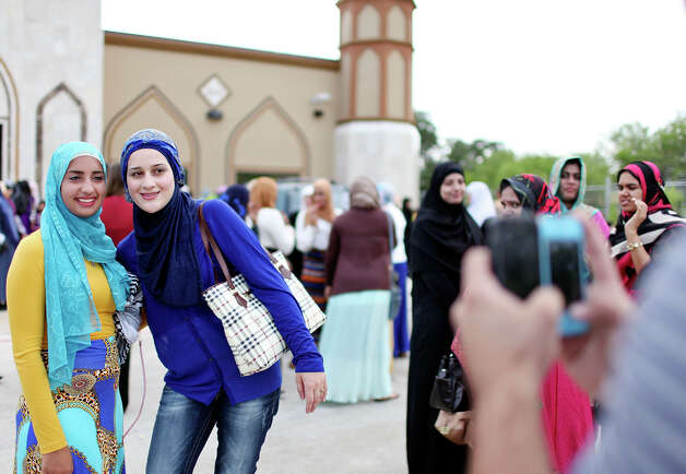 Noor Rafati, 20, (left) and Haifa Haifa, 22, pose for photos after the Eid al-Fitr, end of Ramadan, prayer Sunday Aug. 19, 2012 at the Islamic Center of San Antonio's new mosque. Ramadan is the monthlong fast by Muslims from food, drink, and marital relations from dawn to sunset. Photo: Edward A. Ornelas, San Antonio Express-News / © 2012 San Antonio Express-News