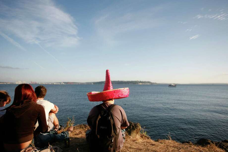 A boy is shown wearing a pink sombrero. Photo: Sofia Jaramillo / SEATTLEPI.COM