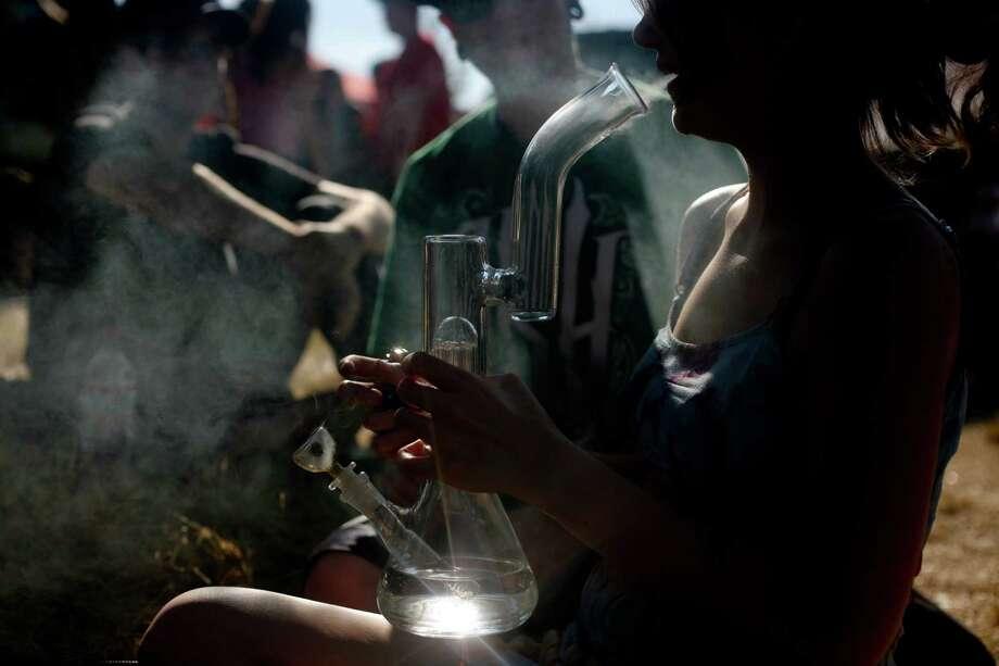 A woman exhales smoke. Photo: Sofia Jaramillo / SEATTLEPI.COM