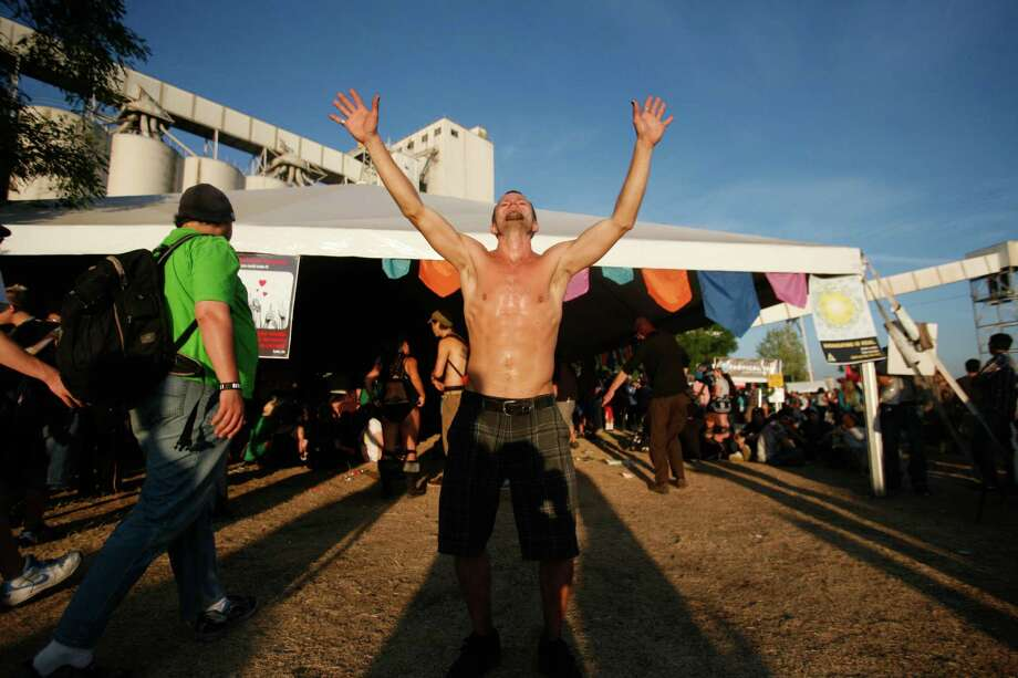 A man dances outside of a tent. Photo: Sofia Jaramillo / SEATTLEPI.COM