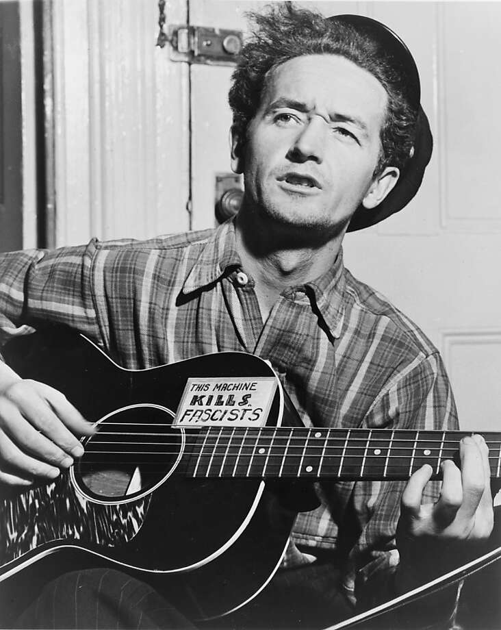 American folksinger and songwriter Woody Guthrie (shown around 1943) remains a favorite of fans 100 years after he was born. Photo: Al Aumuler, NYT