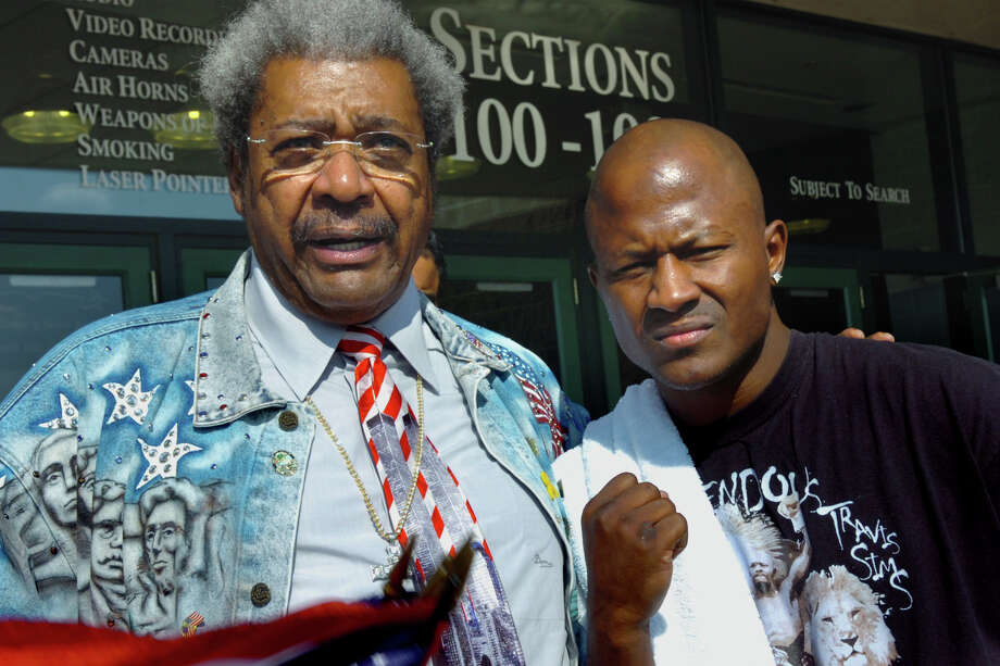 FILE — Don King and boxer Travis Simms of Norwalk pose during a press conference in front of the Arean at Harbor Yard in Bridgeport Thursday afternoon. Simms will fight Joachim Alcine on July 7th. Photo: Ned Gerard / Connecticut Post
