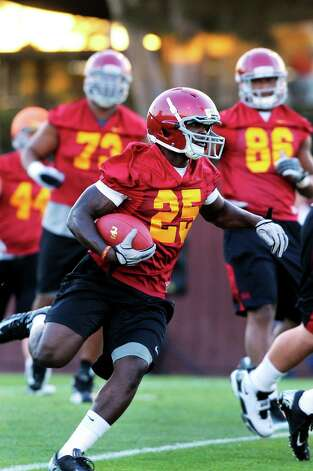 Junior running back Silas Redd at a University of Southern California football practice in August 2012. Redd, a transfer from Penn State, is expected to be a key offensive player for Southern Cal  in the 2012-2013 season. Photo: Contributed Photo / Connecticut Post Contributed