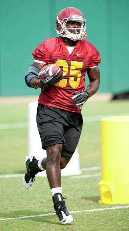 Southern California running back Silas Redd carries the ball during NCAA college football practice in Los Angeles, Friday, Aug. 17, 2012. Photo: Grant Hindsley, Grant Hindsley)/Associated Press / Associated Press