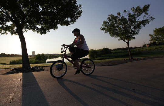 """Weather feels good this morning"" says Melissa Garcia, 20, while riding up hill at Harris County Arthur Storey Park on Monday, Aug. 20, 2012, in Houston. Weather expected to be sunny and muggy today. Photo: Mayra Beltran, Houston Chronicle / © 2012 Houston Chronicle"